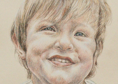 From photo to portrait drawing of a young boy in tinted charcoal on paper - detail
