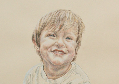 From photo to portrait drawing of a young boy in tinted charcoal on paper
