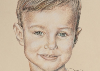 From photo to portrait of a child in tinted charcoal on paper - detail.