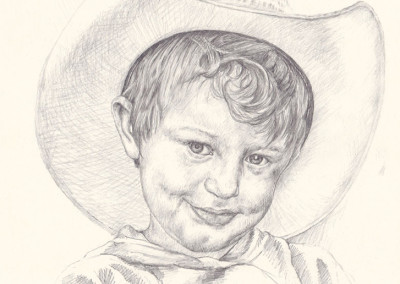 From photo to Portrait. Young boy in a hat, done in graphite on paper