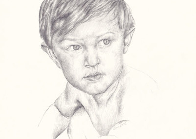 From photo to portrait. A pencil portrait of a young boy squatting