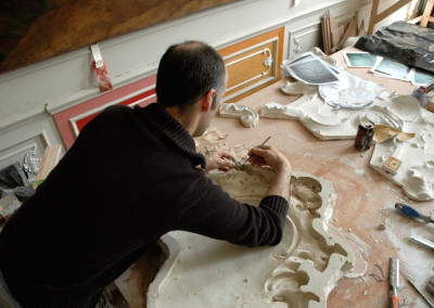 Waste mould being cleaned for casting